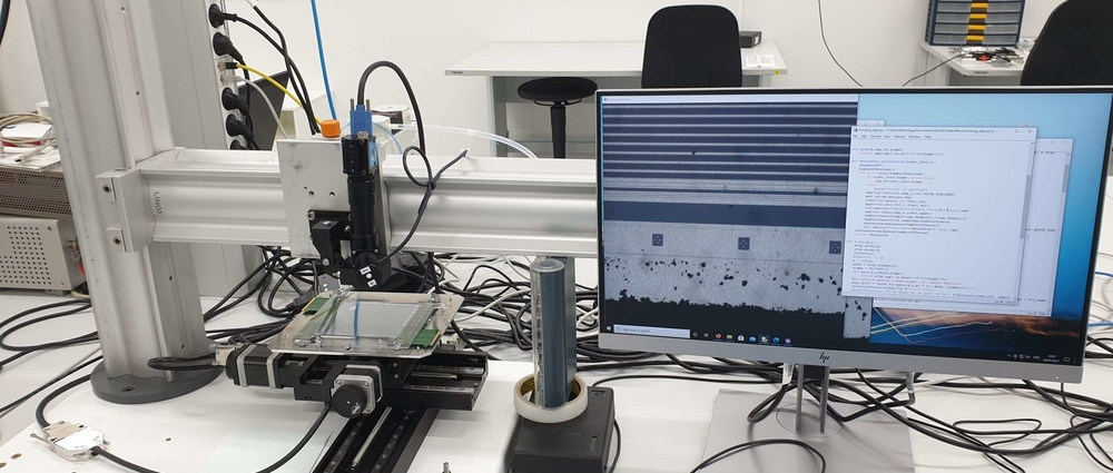 Here a machine measuring CMS sensors, you see the recorded image plus the code for auto focusing